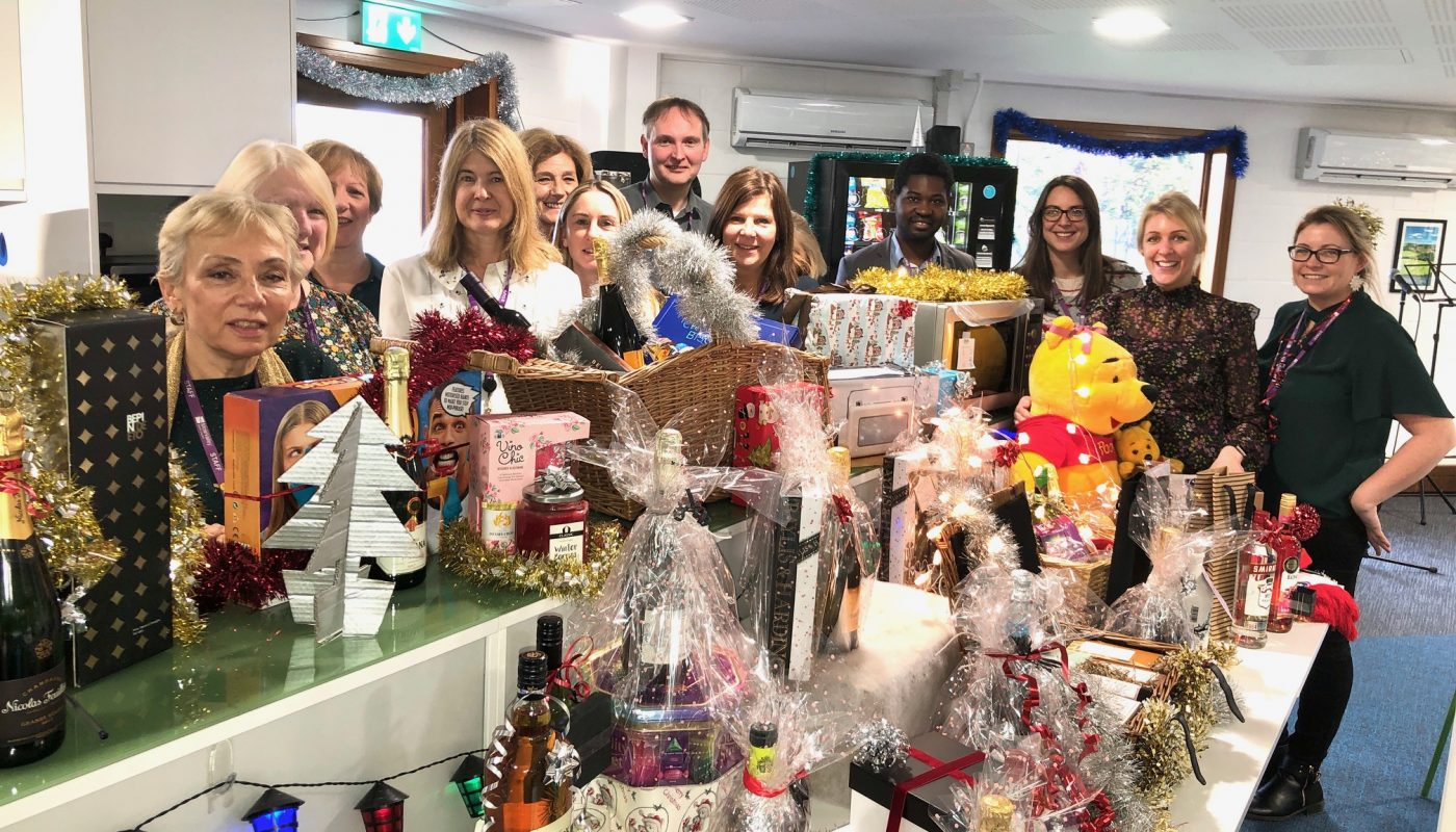 Housing team with raffle prizes